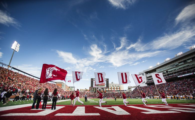 The Cougars wave the flag following a first half scoring drive Saturday against Arizona State.  Arizona State played Washington State Saturday, Nov. 7, 2015 at Martin Stadium in Pullman, WA.  (Dean Rutz / The Seattle Times)