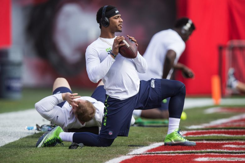 Seahawks quarterback Trevone Boykin stretches as he and the Seahawks warm up. (Dean Rutz / The Seattle Times)