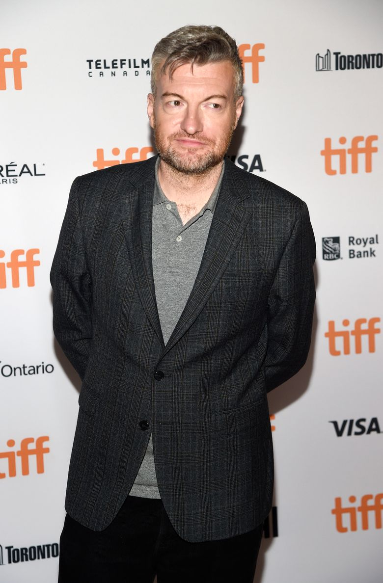 """FILE – In this Sept. 12, 2016 file photo, Charlie Brooker, the creator, writer and executive producer of """"Black Mirror,"""" poses at the premiere of the new season at the Toronto International Film Festival in Toronto. The anthology series takes you through a high-tech looking glass with jittery tales sure to lodge in your brain for years to come. It reclaims the hallowed realm of """"The Twilight Zone"""" for a new millennium. (Photo by Chris Pizzello/Invision/AP, File)"""