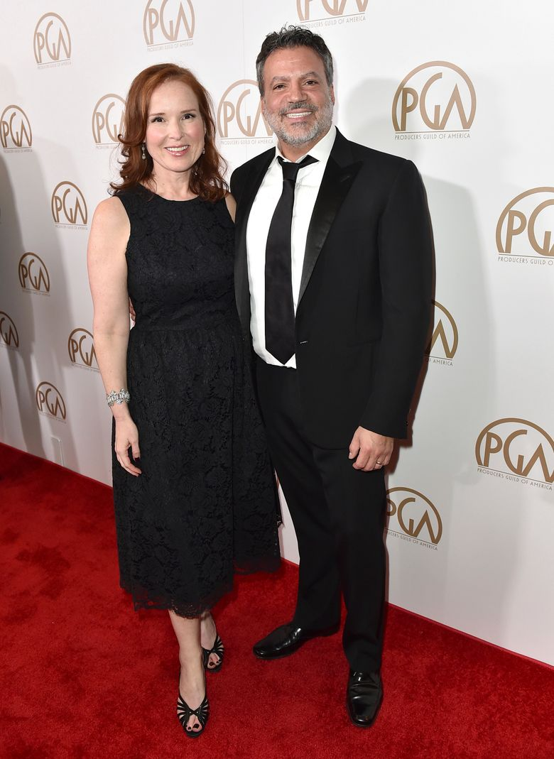 FILE – In this Jan. 23, 2016 file photo released by Producers Guild of America, PGA Chairs Jennifer Todd, left, and Michael De Luca arrive at the 27th annual Producers Guild Awards in Los Angeles. The duo will produce the 89th Academy Awards on Feb. 26, 2017. (Jordan Strauss/Producers Guild of America via AP )