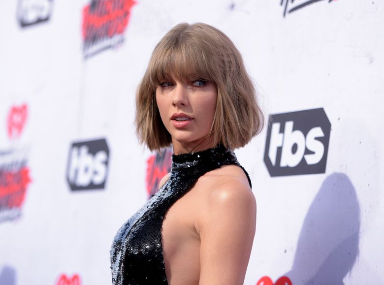 """FILE – In this April 3, 2016 file photo, Taylor Swift arrives at the iHeartRadio Music Awards at The Forum in Inglewood, Calif. Swift posted a video Nov. 24, 2016, of herself and friends taking on the """"mannequin challenge."""" (Photo by Richard Shotwell/Invision/AP, File)"""
