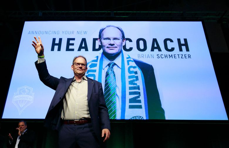 Sounders coach Brian Schmetzer waves to the crowd at the Seattle Sounders‰' 2016 Alliance Annual Business Meeting on Wednesday night. Schmetzer was named head coach at the meeting.  (Erika Schultz / The Seattle Times)