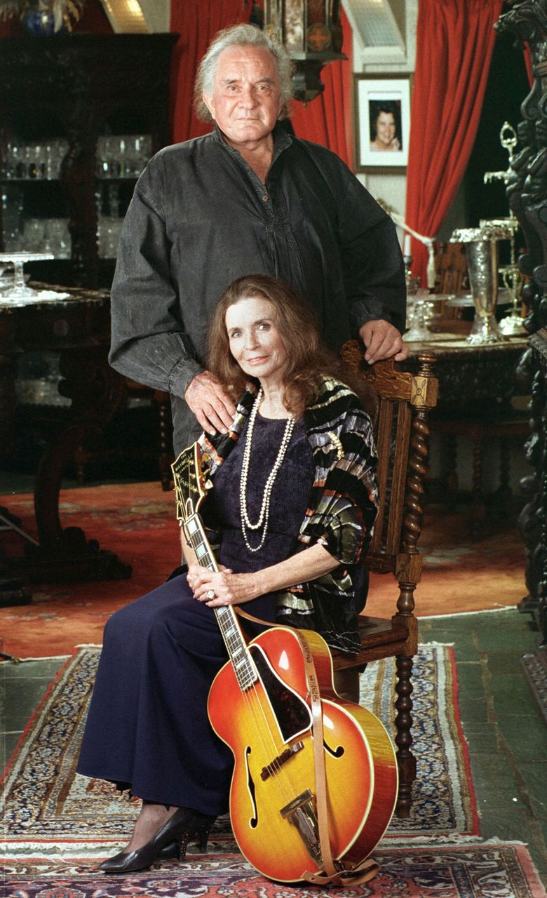 Country music legends Johnny Cash and June Carter Cash, husband and wife for 35 years, at their home in Hendersonville, Tenn., in 1999. She died in May 2003 and he died in September that year. (AP Photo/Mark Humphrey, File)