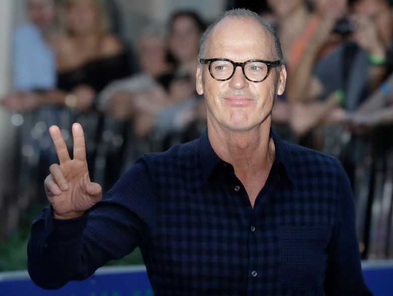 """FILE – In this Sept. 15, 2016, file photo, actor Michael Keaton poses for photographers upon arrival at the world premiere of the film 'The Beatles, Eight Days a Week' in London. Marvel Studios president Kevin Feige confirmed in an interview with the Toronto Sun published on Nov. 2, 2016, that Keaton will play the villain Vulture in """"Spider-man: Homecoming."""" (AP Photo/Kirsty Wigglesworth, File)"""