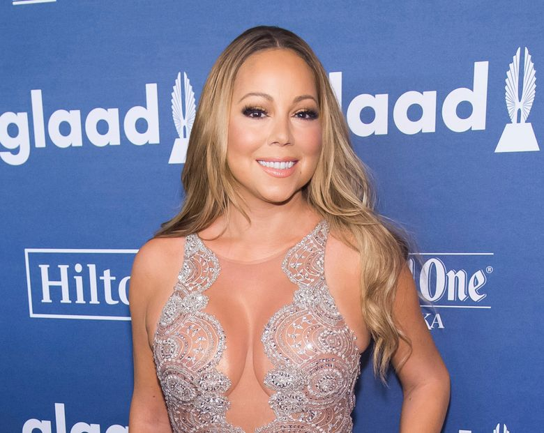 """FILE – In this May 14, 2016 file photo, Mariah Carey attends the 27th Annual GLAAD Media Awards, in New York.  Carey will perform at the """"VH1 Divas Holiday: Unsilent Night"""" concert special that tapes on Dec. 2 in New York. The TV special will air on VH1 on Dec. 5. (Photo by Charles Sykes/Invision/AP, File)"""