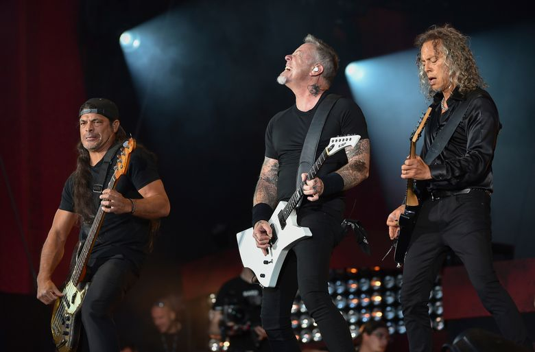 """FILE – In this Sept. 24, 2016, file photo, musicians Robert Trujillo, left, James Hetfield and Kirk Hammett of Metallica perform at the 2016 Global Citizen Festival in Central Park in New York. Metallica joined Jimmy Fallon and The Roots for a toy instrument rendition of its hit, """"Enter Sandman,"""" in a segment that aired on """"The Tonight Show"""" on Nov. 16, 2016. (Photo by Evan Agostini/Invision/AP, File)"""
