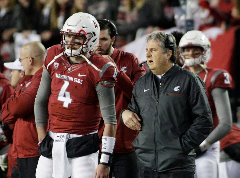 Washington State coach Mike Leach, right, speaks with quarterback Luke Falk (4) during the first half against California. (Young Kwak/AP)
