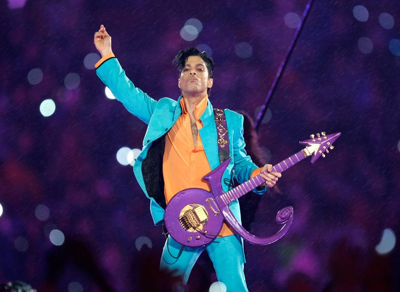 """FILE – In this Feb. 4, 2007 file photo, Prince performs during the halftime show at the Super Bowl XLI football game at Dolphin Stadium in Miami. Universal Music Publishing Group has won the exclusive rights to administer Prince's vast song catalog, from """"Alphabet St."""" to """"Little Red Corvette."""" (AP Photo/Chris O'Meara, File)"""