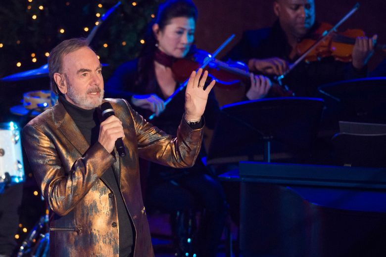 Neil Diamond performs at the 84th Annual Rockefeller Center Christmas Tree lighting ceremony on Wednesday, Nov. 30, 2016, in New York. (Photo by Charles Sykes/Invision/AP)