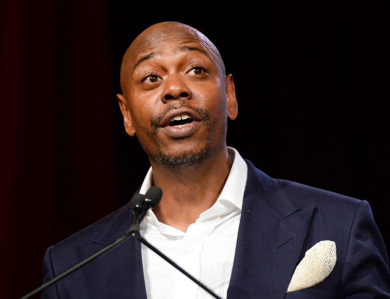 FILE – In this July 18, 2015 file photo, comedian Dave Chappelle speaks at the RUSH Philanthropic Arts Foundation's Art for Life Benefit in New York. Chappelle is headed back to TV with his first concert specials in a dozen years. A trio of specials will be released on Netflix simultaneously in 2017. (Photo by Scott Roth/Invision/AP, File)