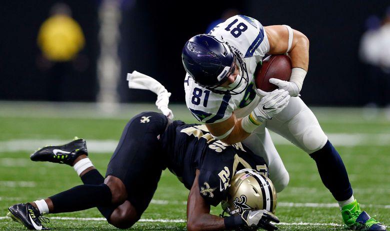 Seattle Seahawks tight end Nick Vannett (81) is stopped by New Orleans Saints cornerback De'Vante Harris (21). (Butch Dill/AP)