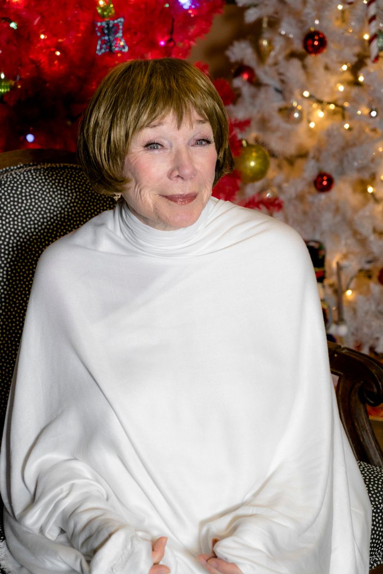 """In this image released by the Hallmark Channel, actress Shirley MacLaine plays an angel in """"A Heavenly Christmas,"""" a Hallmark Hall of Fame TV movie airing 8 p.m. EST Saturday on the Hallmark Channel.  (Chris Helcermanas-Benge/Crown Media United States LLC via AP)"""
