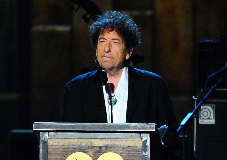 FILE – In this Feb. 6, 2015 file photo, Bob Dylan accepts the 2015 MusiCares Person of the Year award at the 2015 MusiCares Person of the Year show in Los Angeles.  The Swedish Academy says Dylan is not coming to Stockholm to pick up his 2016 Nobel Prize for literature at the Dec. 10, 2016 prize ceremony.  (Photo by Vince Bucci/Invision/AP, File)