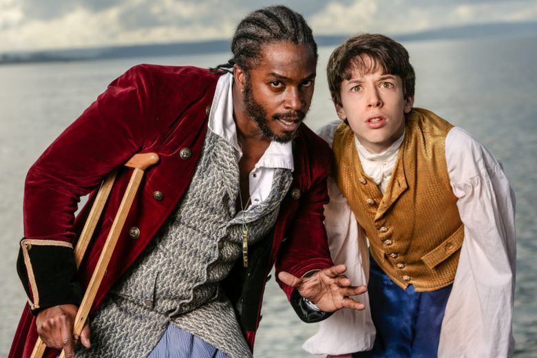 """Geoffery Simmons, left, as Long John Silver and Alex Silva as Jim Hawkins in Book-It Repertory Theatre's production of """"Treasure Island."""""""