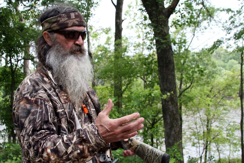 """FILE – This May 15, 2013 file photo shows Phil Robertson, the family patriarch the Robertsons of the television series, """"Duck Dynasty,"""" posing for a photograph at his home in western Ouachita Parish in Monroe, La. The """"Duck Dynasty"""" family says its A&E series will end after this season. Their announcement was paired with the debut episode of the show's 11th season on Wednesday, Nov. 16, 2016.  (Margaret Croft/The News-Star via AP, File)"""