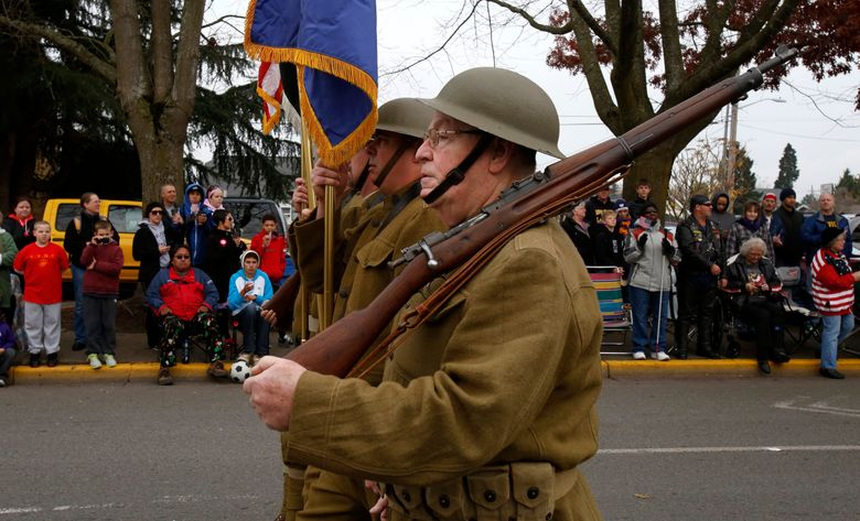 World War I doughboys are represented by American Legion Post #138 at a past Veterans Day Parade in Auburn.  (Alan Berner/The Seattle Times)