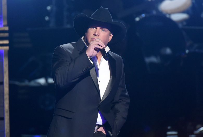 """FILE – In this Nov. 2, 2016 file photo, Garth Brooks performs at the 50th annual CMA Awards in Nashville, Tenn. NBC said Monday, Nov. 7, that Brooks will be a key adviser on """"The Voice"""" next week, mentoring the show's top 12 contestants. (Photo by Charles Sykes/Invision/AP, File)"""