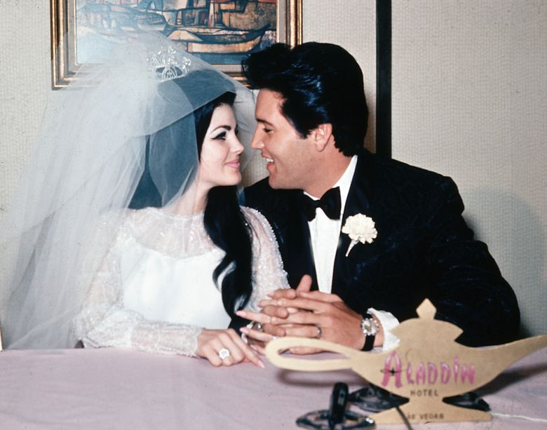 """FILE – In this May 1, 1967, file photo, singer Elvis Presley and his bride, the former Priscilla Beaulieu, appear at the Aladdin Hotel in Las Vegas, after their wedding. Priscilla Presley opened up about her life with Elvis during a Nov. 16, 2016, interview on British chat show, """"Loose Women,"""" on the ITV network. (AP Photo/File)"""