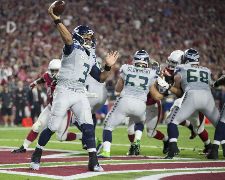 Some might say that off the field, Seattle's Russell Wilson (3) is too mundane, too predictable. But that approach makes him an unpredictable force on the field.  (Dean Rutz/The Seattle Times)