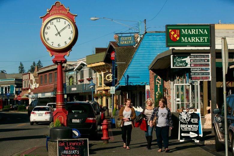 """Family members Katie Trammell, from left, Shelly Hesch and Misty Walker visit Front Street in downtown Poulsbo, which calls itself """"Little Norway.""""  (Erika Schultz/The Seattle Times)"""