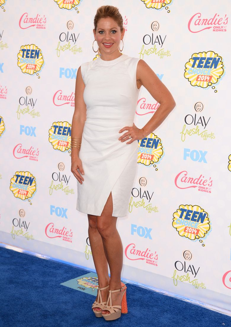 """FILE – In this Aug. 10, 2014, file photo, Candace Cameron Bure arrives at the Teen Choice Awards at the Shrine Auditorium in Los Angeles. There's another departure on television's """"The View,"""" with Bure saying she can no longer handle the bicoastal life made necessary by her acting career. Bure said on the Thursday, Dec. 8, 2016 show: """"I tried to be superwoman but I am going to not try anymore."""" (Photo by Jordan Strauss/Invision/AP, File)"""