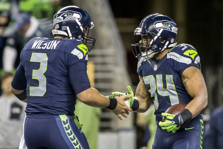 Seahawks quarterback Russell Wilson and Seahawks running back Thomas Rawls celebrate Rawls' first of two touchdowns as the Seattle Seahawks take on the Carolina Panthers, Sunday December 4, 2016 at CenturyLink Field in Seattle.  (Bettina Hansen/The Seattle Times)