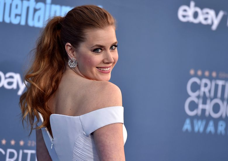 """FILE – In this Sunday, Dec. 11, 2016, file photo, Amy Adams arrives at the 22nd annual Critics' Choice Awards at the Barker Hangar in Santa Monica, Calif. New Year's Eve is the jam of the year, so Adams and a slew of other celebs said what's on their party playlists. """"We usually do some karaoke, so you know a little bit of heavy metal comes up, """" Adams said. """"I'm a closet hardcore 1980s power ballad singer."""" (Photo by Jordan Strauss/Invision/AP, File)"""