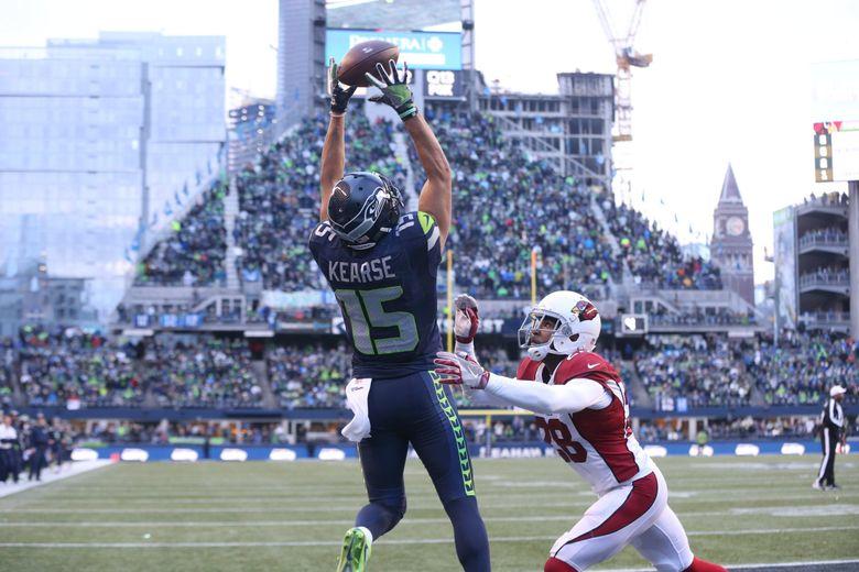 Seahawks wide receiver Jermaine Kearse scores a touchdown versus the Arizona Cardinals at CenturyLink Field on  Dec. 24.  (Bettina Hansen / The Seattle Times)