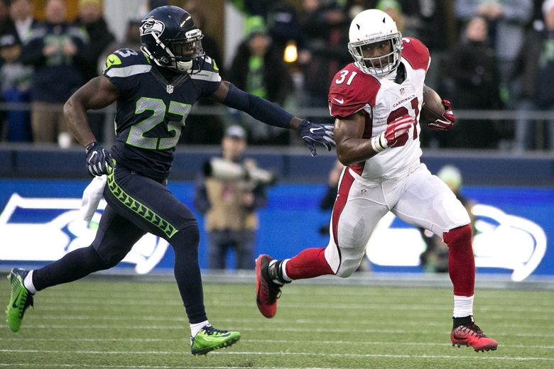 Cardinals running back David Johnson breaks free for a  33-yard run in the fourth quarter as Seattle Seahawks free safety Steven Terrell (23) pursues for the tackle.  (Johnny Andrews / The Seattle Times)