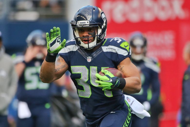 Seahawks running back Thomas Rawls warms up before the game against Arizona Saturday.