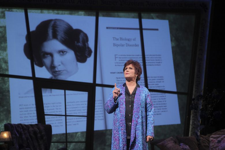 """Carrie Fisher, shown in 2009 performing her autobiographical one-woman show """"Wishful Drinking"""" at Studio 54 in New York. (Sara Krulwich/The New York Times)"""