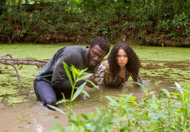 """This image released by WGN shows Aldis Hodge, left, and urnee Smollett-Bell in a scene from """"Underground."""" WGN America's drama """"Underground"""" is set to premiere its second season on March 8, 2017.  Set in a divided America on the brink of the Civil War, the 10-episode season will add to the cast Aisha Hinds playing abolitionist Harriet Tubman as its characters continue their underground journey to freedom. (Skip Bolen/Sony Pictures Television via AP)"""