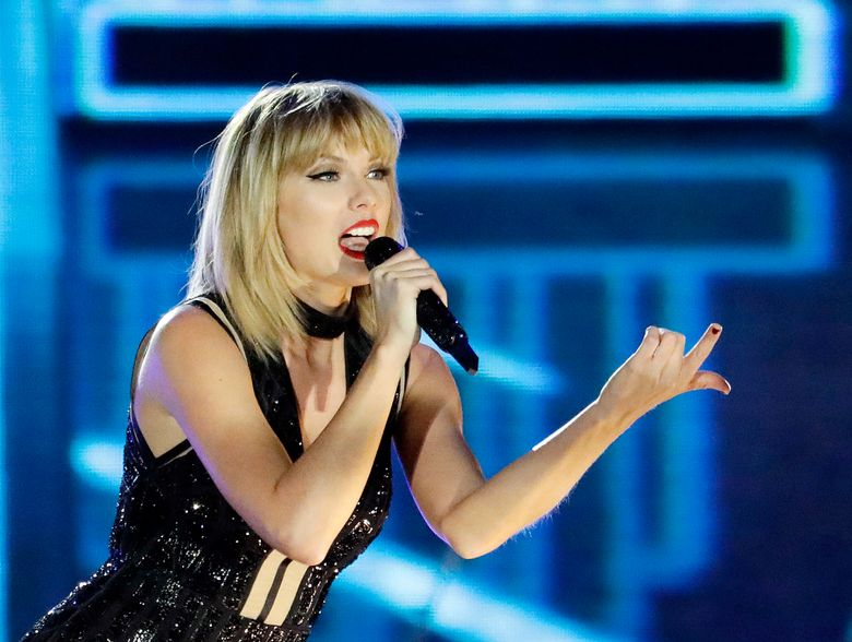 """FILE – In this Oct. 22, 2016 photo, Taylor Swift performs in Austin, Texas. Ninety-six-year-old Cyrus Porter is a devoted Taylor Swift fan and has traveled to her shows, but on Monday, Dec. 26 2016, he didn't have to go anywhere, Swift came to him. Swift had learned about the World War II combat veteran's fandom and decided to surprise him. A day after Christmas a van carrying Swift pulled into the driveway of his home in New Madrid, Mo. The singer stayed about an hour and sang """"Shake It Off"""" as Porter's relatives sang along. (AP Photo/Darron Cummings, File)"""