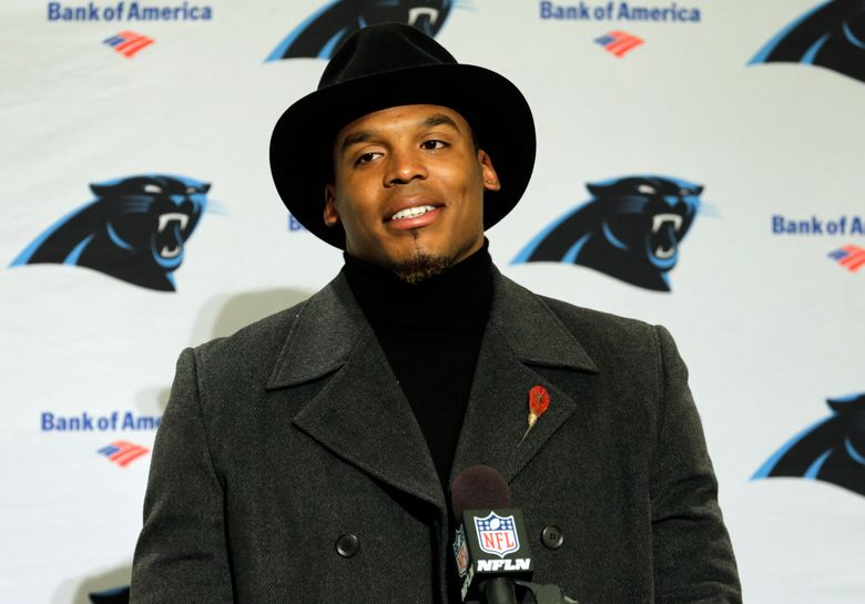 Carolina Panthers quarterback Cam Newton wears a black coat and hat as he talks with reporters during a post-game news conference after an NFL football game against the Seattle Seahawks, Sunday, Dec. 4, 2016, in Seattle. The Seahawks won 40-7. (AP Photo/Stephen Brashear)