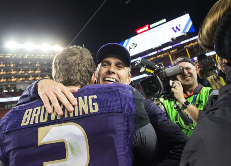 Washington head coach Chris Petersen finds Washington quarterback Jake Browning in the crowd as they celebrate winning the Pac-12 championship. Washington beat Colorado 41-10 in the Pac-12 Championship Game, each playing for the first time, at Levi's Stadium in Santa Clara, Calif., on Friday, Dec. 2, 2016.  (Lindsey Wasson/The Seattle Times)