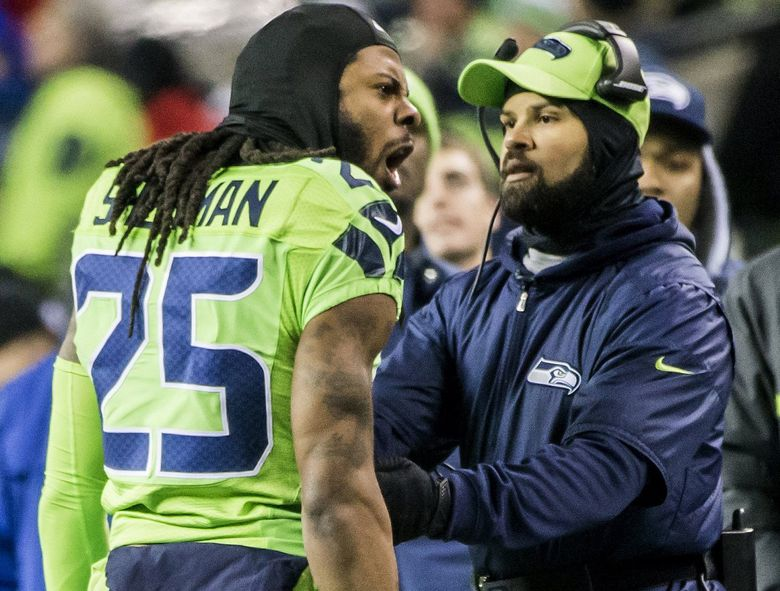 Defensive coordinator Kris Richard holds back Seahawks cornerback Richard Sherman after he got mad about something in the third quarter as the Seattle Seahawks take on the Los Angeles Rams at CenturyLink Field, (Bettina Hansen/The Seattle Times)