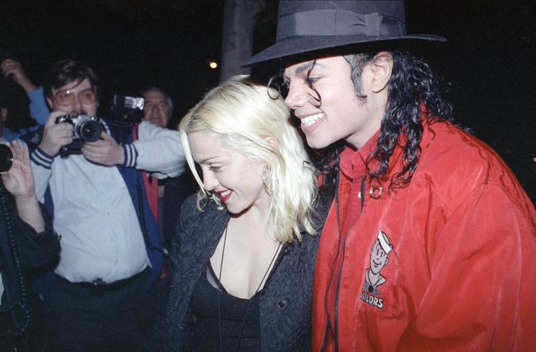 """FILE – In this April 10, 1991, file photo, Madonna and Michael Jackson go out for dinner together at a restaurant in Los Angeles. Madonna told CBS' James Corden in an appearance on """"The Late Late Show,"""" Wednesday, Dec. 7, 2016, that she made out with Jackson once after giving him a glass of win. (AP Photo/Kevork Djansezian, File)"""