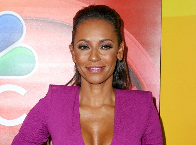 """FILE – In this Aug. 2, 2016, file photo, Melanie Brown a judge in the television series """"America's Got Talent,"""" arrives at the NBCUniversal Television Critics Association summer press tour in Beverly Hills, Calif. Brown will join """"Chicago"""" on Broadway, playing jailed killer Roxie Hart starting Dec. 28. (Photo by Rich Fury/Invision/AP, File)"""