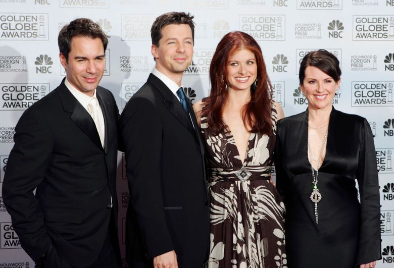 """FILE – In this Jan. 16, 2006 file photo, cast members from the comedy series """"Will & Grace,"""" from left, Eric McCormack, Sean Hayes, Debra Messing and Megan Mullally, pose backstage after making an award presentation at the 63rd Annual Golden Globe Awards in Beverly Hills, Calif. Mullally hinted in an interview with PrideSource published on Dec. 7, 2016, that a revival of the series could be in the works. (AP Photo/Reed Saxon, File)"""