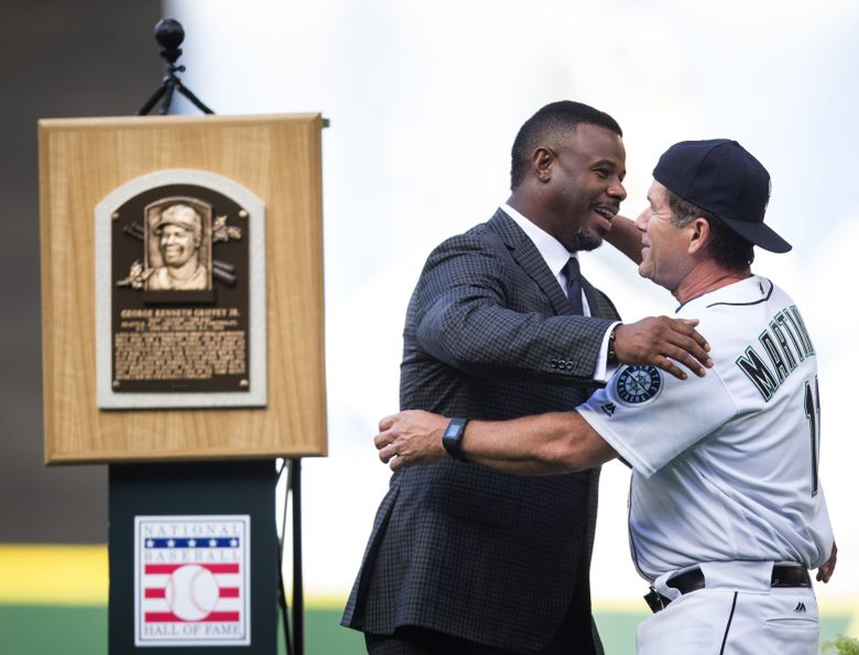 Ken Griffey Jr. greets former teammate Edgar Martinez during a pregame ceremony to retire the jersey number of recent Hall of Fame inductee Ken Griffey Jr. at Safeco Field on Saturday, Aug. 6, 2016 before a game against the Los Angeles Angels. No player in the Mariners organization will wear the number 24 again, which will now hang in Safeco Field's rafters next to Jackie Robinson's number 42.  (Lindsey Wasson/The Seattle Times)