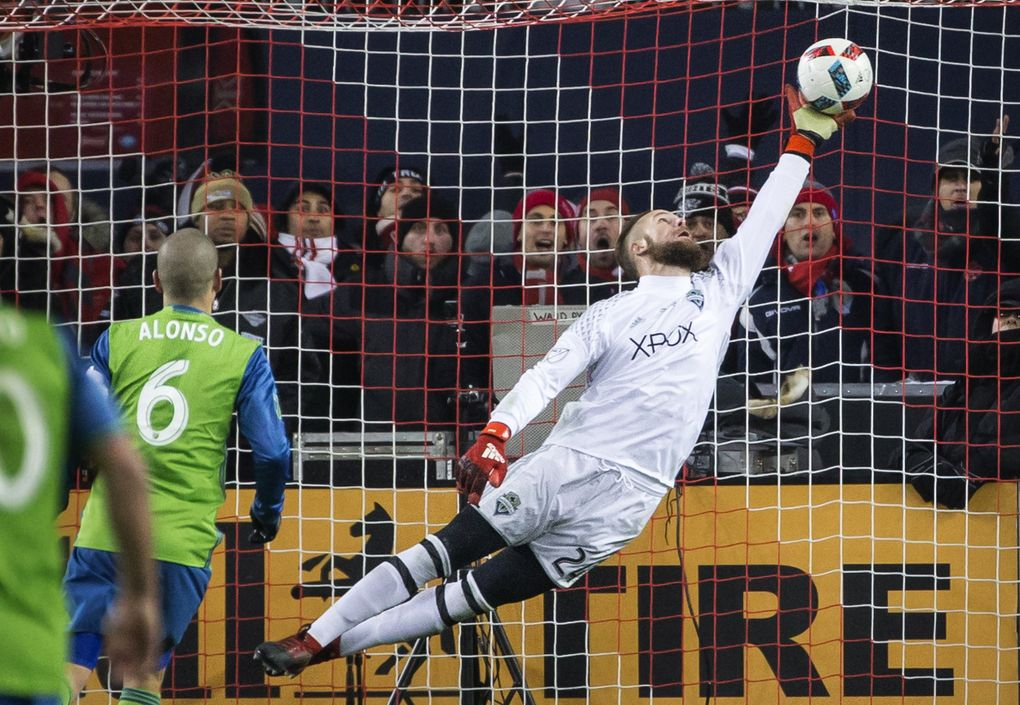 Sounders keeper Stefan Frei had a key save to help his team beat Toronto for the MLS Cup, and it was memorialized in this photo. The Sounders won only six of their first 20 matches that season.  (Lindsey Wasson/Seattle Times)