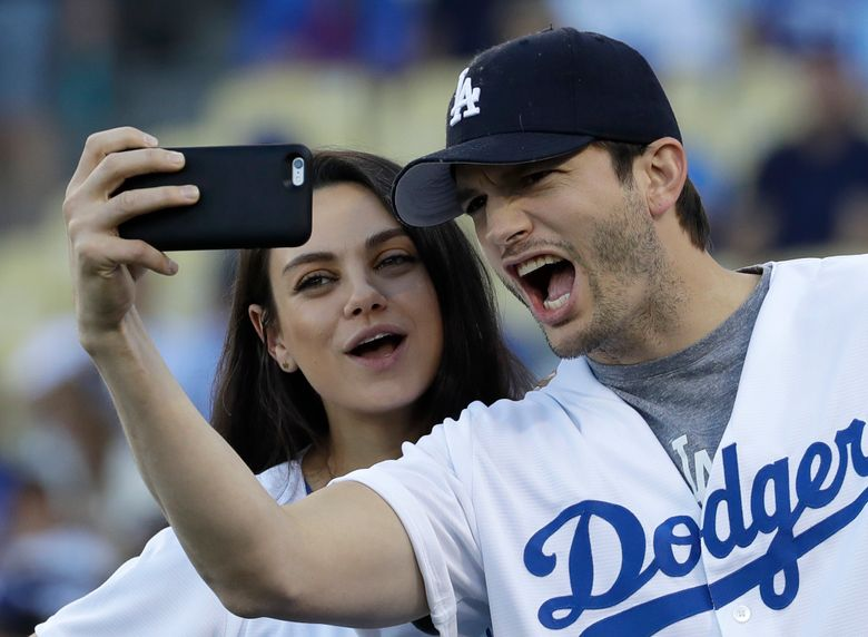 FILE- In this Oct. 19, 2016, file photo, Ashton Kutcher and wife Mila Kunis take a selfie before Game 4 of the National League baseball championship series between the Chicago Cubs and the Los Angeles Dodgers in Los Angeles. Kunis and Kutcher are parents for the second time. A publicist for the actress said in an email Thursday, Dec. 1, that Kunis had given birth. (AP Photo/David J. Phillip, File)