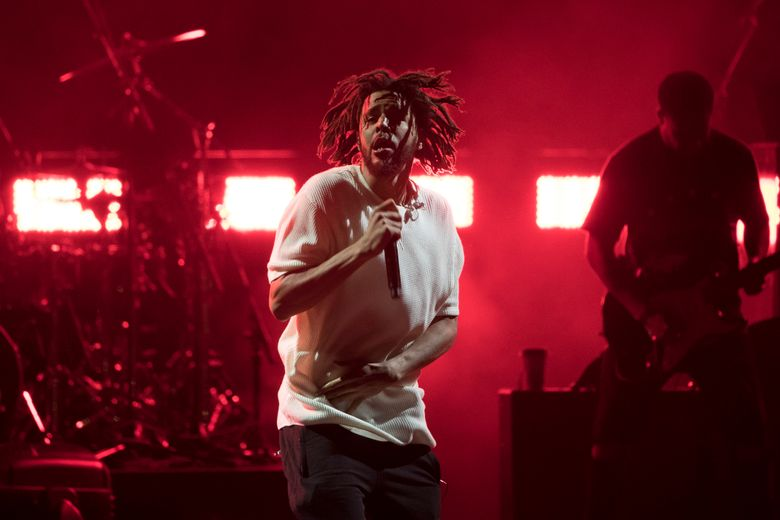 """FILE – In this Nov. 4, 2016, file photo, J. Cole performs during a campaign rally for Democratic presidential candidate Hillary Clinton in Cleveland. A track off J. Cole's forthcoming album has some speculating the rapper is taking shots at Kanye West. """"False Prophets"""" is included on Cole's """"4 Your Eyez Only,"""" which is set for release on Dec. 9, 2016. (AP Photo/Matt Rourke, File)"""