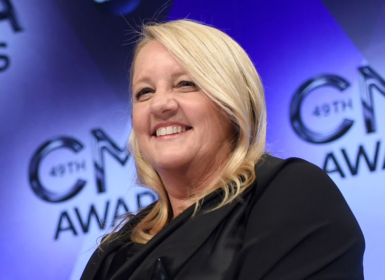 """FILE – In this Nov. 4, 2015 file photo, Liz Rose, one of three winners of the award for song of the year for """"Girl Crush,"""" poses in the press room at the 49th annual CMA Awards in Nashville, Tenn. Rose penned the inspirational song, """"Watch Me Shine,"""" an original song featuring backup vocals from actual Girl Scouts. The track is being used in a Girl Scouts PSA called """"I'm Prepared,"""" which praises girls for being leaders, risk-takers, problem solvers and innovators. (Photo by Evan Agostini/Invision/AP, File)"""