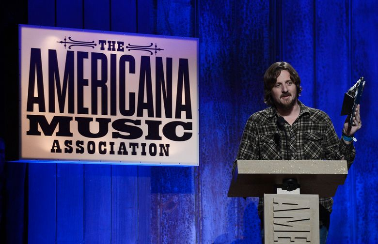 """FILE- In this Sept. 17, 2014, file photo, Sturgill Simpson accepts the Emerging Artist of the Year Award during the Americana Music Honors and Awards show in Nashville, Tenn. Simpson's album, """"A Sailor's Guide to Earth,"""" was the surprise underdog nomination for the all-genre album of the year category on Tuesday, Dec. 6, 2016, when Grammy nominations were announced. (AP Photo/Mark Zaleski, File)"""