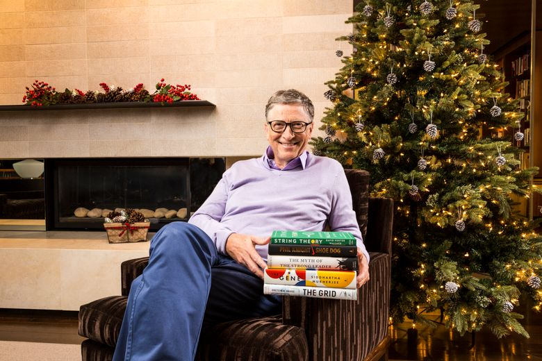 Bill Gates with his favorite books of 2016. (Courtesy of GatesNotes.com)
