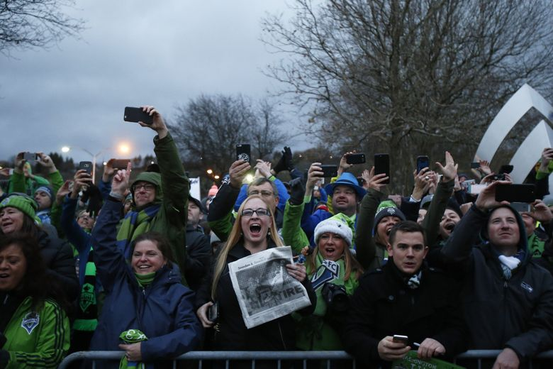 Fans greet the Seattle Sounders at Boeing Field on Sunday.  (Logan Riely/The Seattle Times)