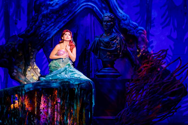 """Diana Huey as Ariel, the mermaid who wants to be a landlubber, in The 5th Avenue Theatre's production of """"The Little Mermaid."""" (Mark Kitaoka)"""