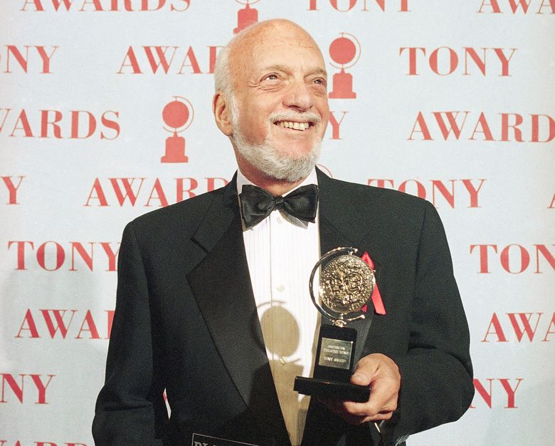 """Harold Prince holds his Tony award in 1995 for best director in a musical for """"Show Boat,"""" at Broadway's Minskoff Theater in New York. Mr. Prince died Wednesday. (AP Photo/Richard Drew, file)"""