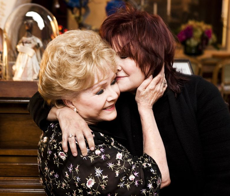 Debbie Reynolds and her daughter, Carrie Fisher, at Fisher's home in Beverly Hills, Calif., in November 2010. Fisher died Tuesday and Reynolds a day later.  (KEVIN SCANLON/NYT)